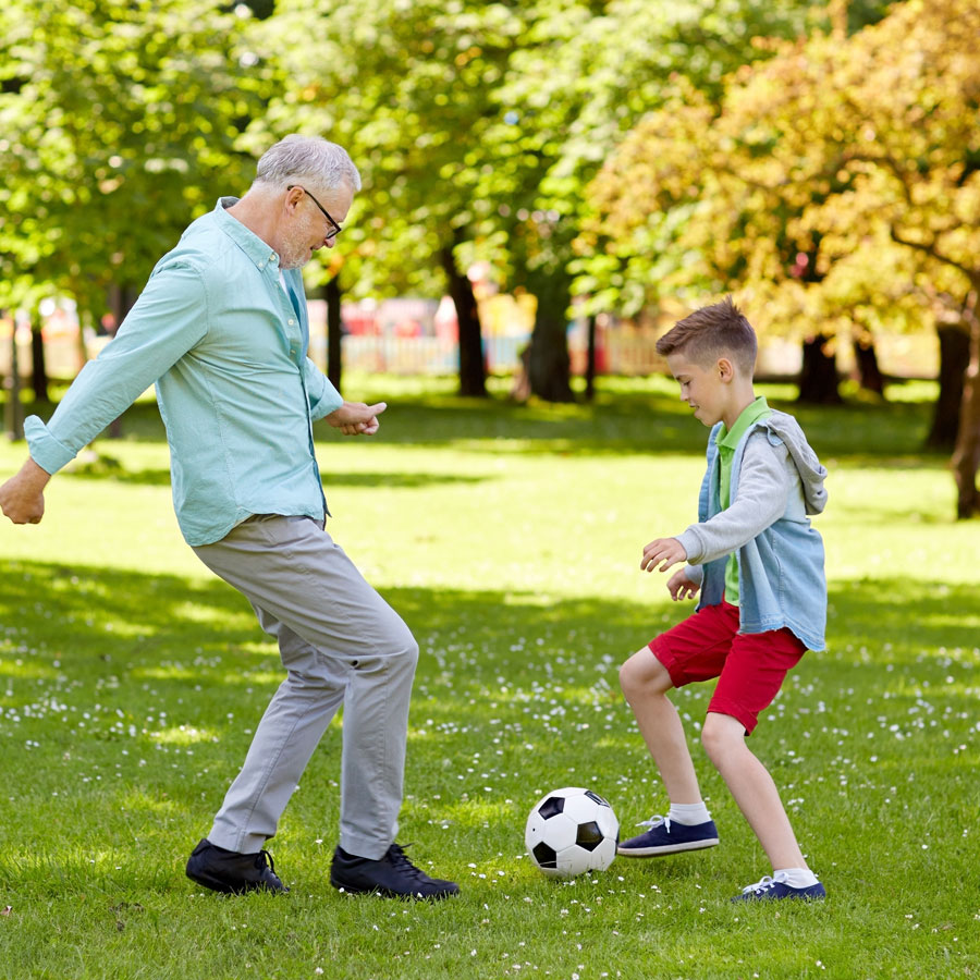 grandpa and son playing soccer