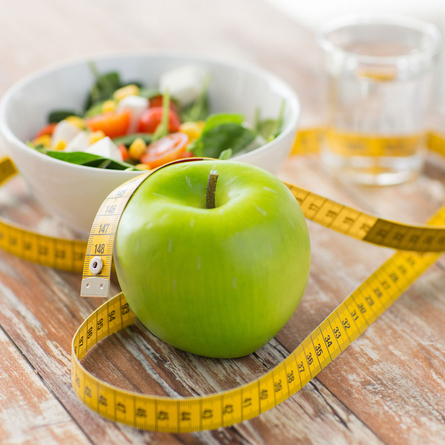 salad, apple, and tape measure