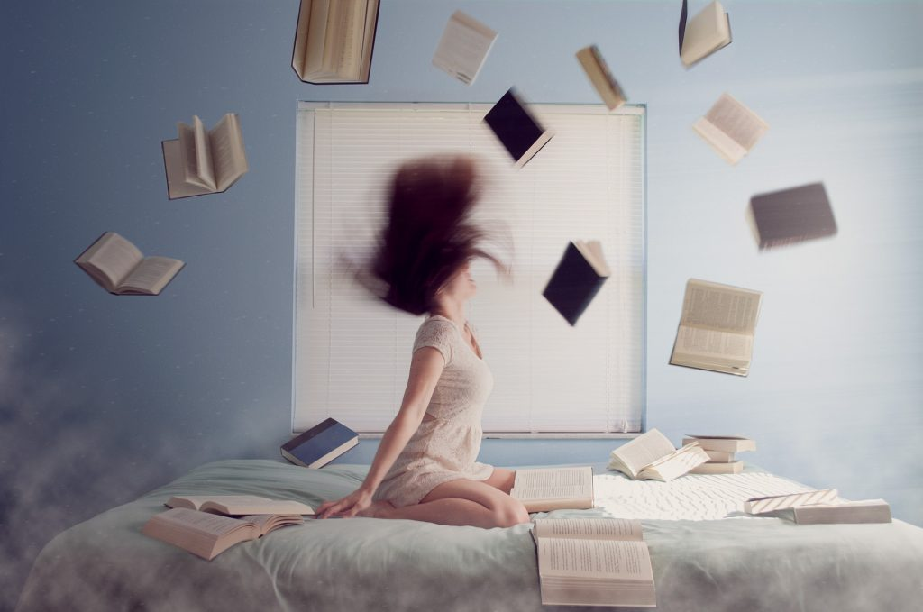 Stressed Woman Throwing Books