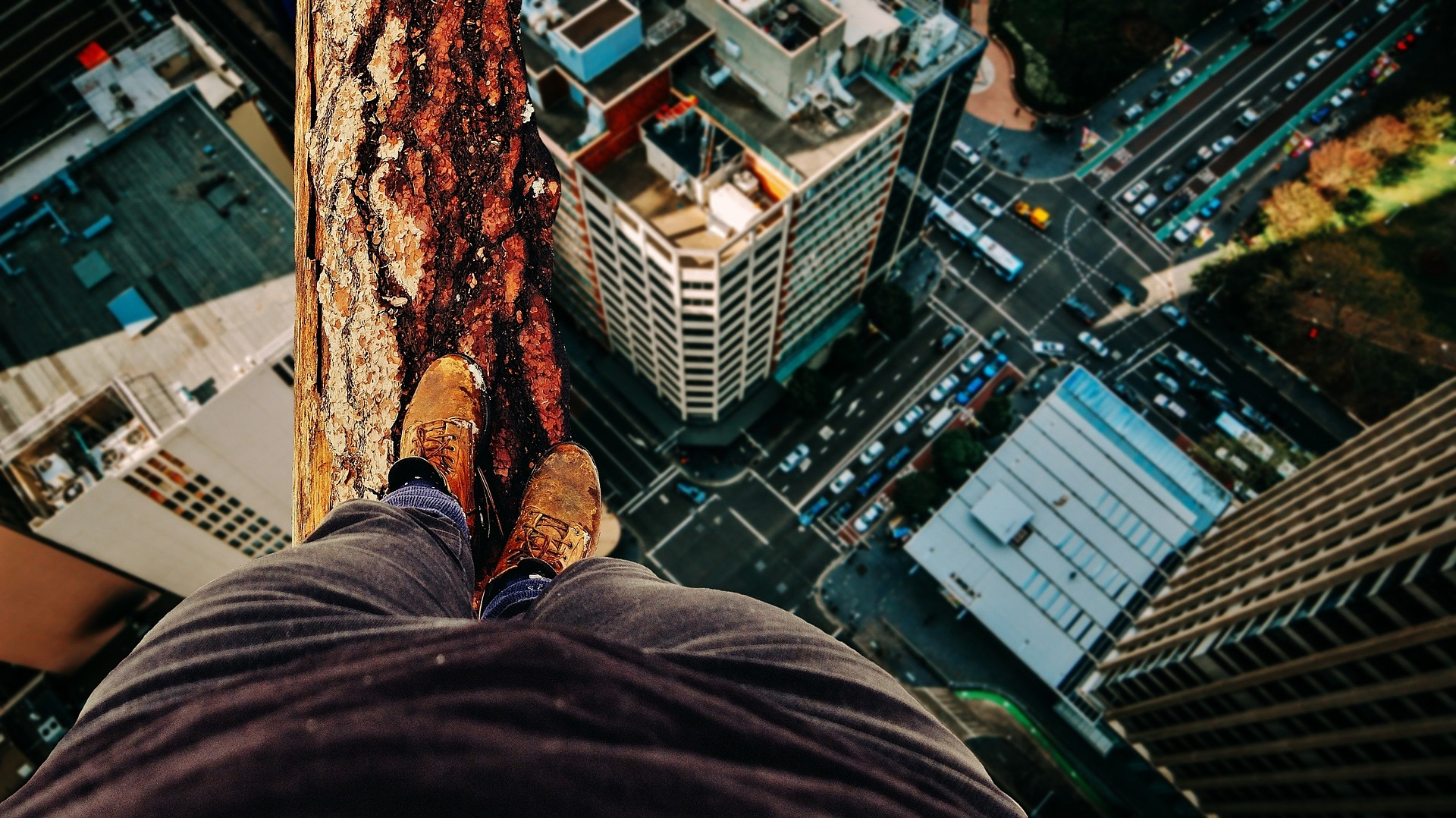 Man balancing over city